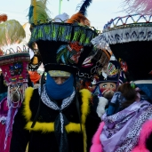 Chinelos, masked dancers, perform in a Candlemas parade in Xochimilco, 2019.