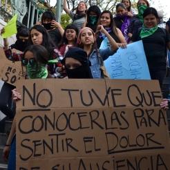Feminist protestors enter the Bellas Artes metro station in downtown Mexico City Feb. 21, 2020.
