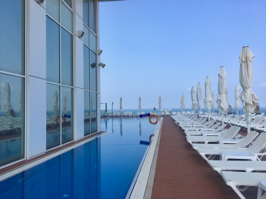 The view of a calm pool in Netanya, Israel, looking out onto the Mediterranean Sea.