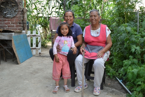 Severa Galicia Flores (right) sits in her front garden with her daughter Elena Hernández Galicia and granddaughter Melissa Fuentes Hernández